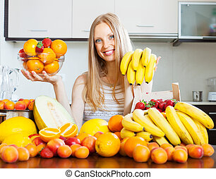 Positive woman with bananas and other fruits