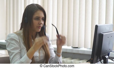 positive woman working in the call center