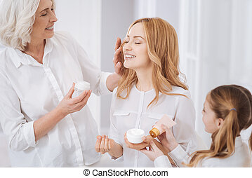 Positive women enjoying beauty treatment at home