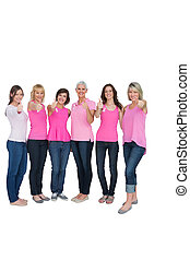 Positive women posing with pink top for breast cancer