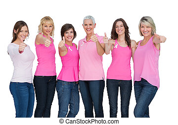 Positive women wearing pink for breast cancer posing