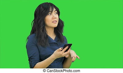 Positive young beautiful asian woman using mobile phone,...