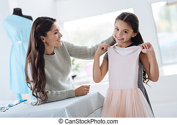 Positive young girl being happy about the dress
