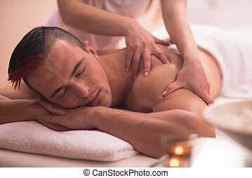 young man having a back massage