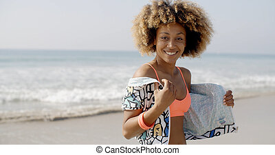 Positive Young Woman On The Beach