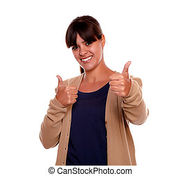 Positive young woman showing you ok sign