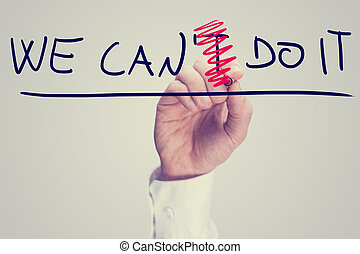Male hand erasing letter T from a phrase We can't do it. Positivity and determination concept.