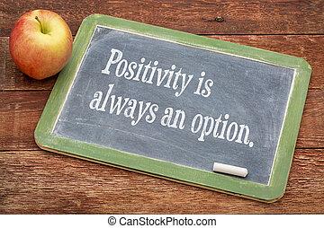 Positivity is always an option - text on a slate blackboard against red barn wood