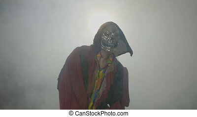 Possessed creature wearing a scary mask celebrating day of...