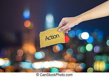 possession main, a, action, signe, fait, sur, sucre, papier, à, lumière ville, bokeh, comme, fond