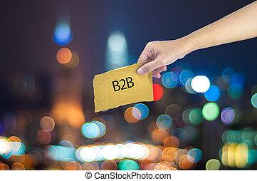 possession main, a, b2b, signe, fait, sur, sucre, papier, à, lumière ville, bokeh, comme, fond