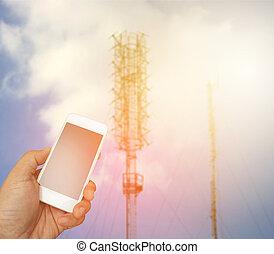 possession main, les, smartphone, sur, brouillé, télécommunication, radio, antenne, fond, à, éclater, lumière