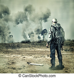 Post apocalypse. Man in gas mask with handgun and back pack...