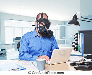 post atomic worker - man wearing gas mask work with laptop