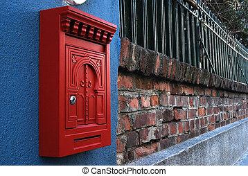Post box on brick wall