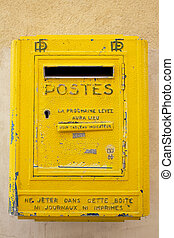 Post Box - Yellow wall mounted post box in France