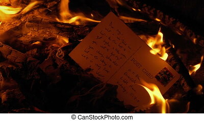 Post Card Burns In Fire - Generic Content - Post card is put...