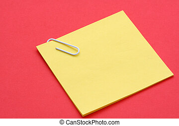 Post-it note - Blank yellow note on red background