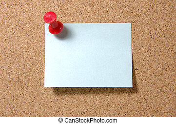 Post-it note with pushpin on corkboard - Blue post-it note...
