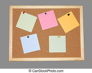 Post-it notes on a cork board - various post-it notes on a...