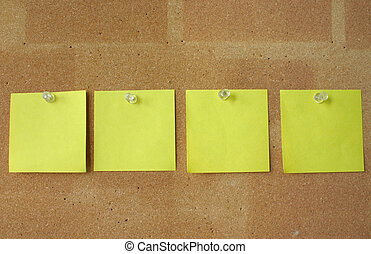 post-it notes pinned in line