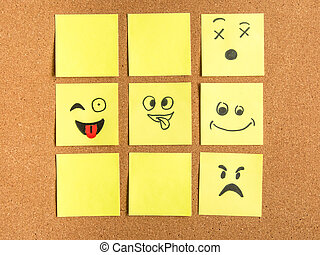 post-it notes with different face expression arranged as a tic tac toe games on cork board office school abstract concept photo