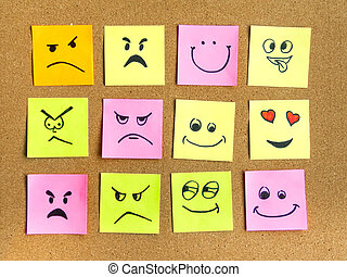 post-it notes with different face expression on cork board office school abstract concept photo