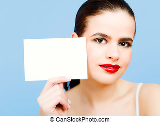 Post It - Young woman with blank piece of paper.