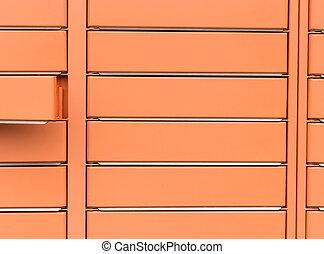Post office box, the door is open. Orange post box for rentals.