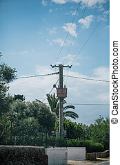 Post with wires in italy