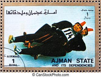Postage stamp Ajman 1973 Two-man Sledge, Winter Olympics