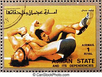 Postage stamp Ajman 1973 Wrestling, Olympic sports