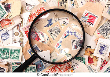 postage stamp and magnify glass