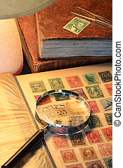 Still life with old stamp album and table lamp