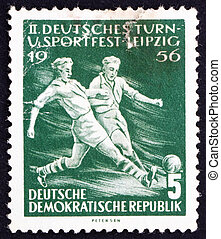 GDR - CIRCA 1956: a stamp printed in GDR shows Soccer Players, Second Sports Festival, Leipzig, circa 1956