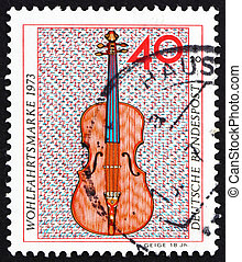 GERMANY - CIRCA 1973: a stamp printed in the Germany shows Violin, 18th Century, Musical Instrument, circa 1973