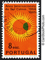 PORTUGAL - CIRCA 1964: a stamp printed in the Portugal shows Partial Eclipse of Sun, International Quiet Sun Year, circa 1964