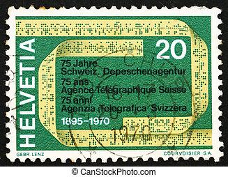 SWITZERLAND - CIRCA 1970: a stamp printed in the Switzerland shows Telex Tape, 75th Anniversary of the Swiss Telegraph Agency, circa 1970