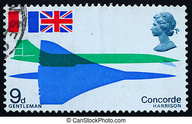 GREAT BRITAIN ? CIRCA 1969: a stamp printed in the Great Britain shows Concorde seen from above and from side and flags of France and Great Britain, circa 1969