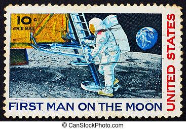 UNITED STATES OF AMERICA - CIRCA 1969: a stamp printed in the United States of America shows Man?s 1st landing on the moon, Apollo 11, circa 1969