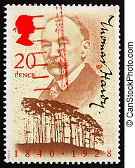 GREAT BRITAIN ? CIRCA 1990: a stamp printed in the Great Britain shows Thomas Hardy, Writer and Clyffe Clump, Dorset, circa 1990