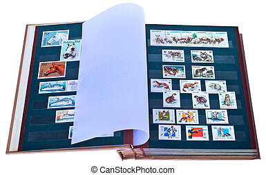 Postage stamps in album.