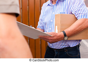 Postal service - delivery of a package; the postman is...
