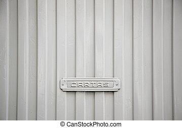 Postbox on a door
