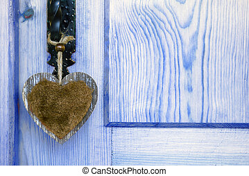 postcard love country style - door with a hanging heart,...