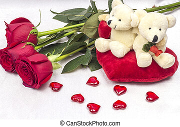 Postcard on Valentines day with roses and a soft toy.