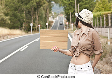poster girl hitchhiking on the road