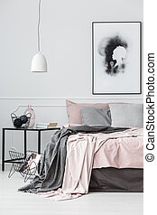 Poster in bright bedroom interior