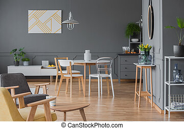 Poster in grey apartment interior - White chairs at dining...