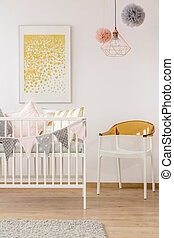 Poster over cozy nursery crib